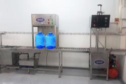 Máy chiết rót nước bình nước bán tự động
